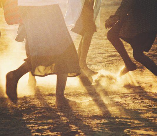 African Children Soccer Feet at Sunset