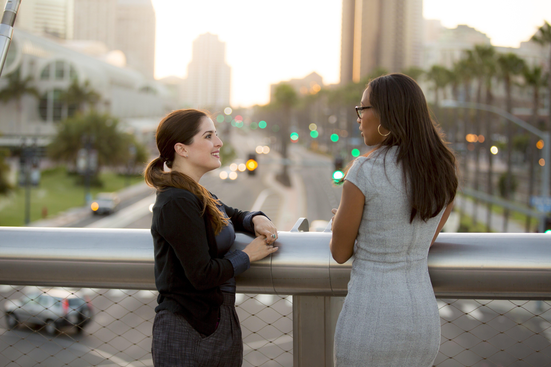 Businesswomen having a conversation on a bridge