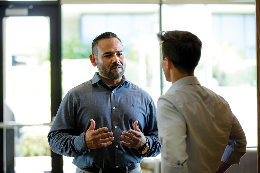 Alfonso Esquer, M.S.W., Director of PLNU's Criminal Justice adult degree completion program, talks with a student.