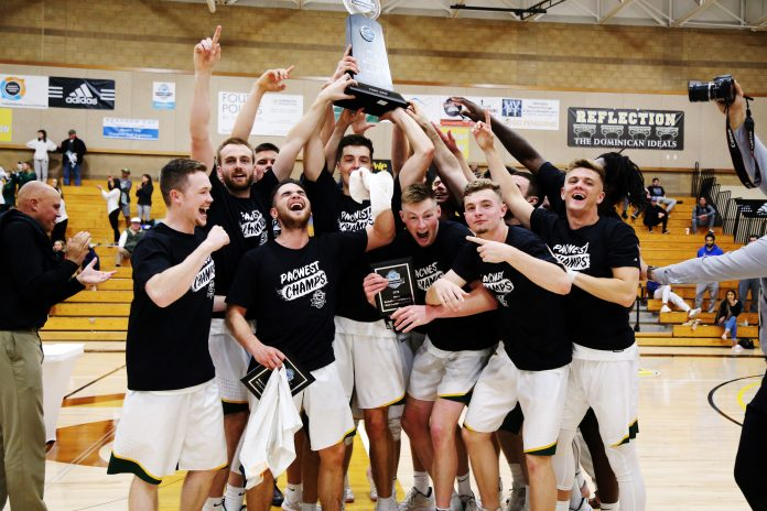PLNU mens basketball team celebrates winning the PacWest Championship