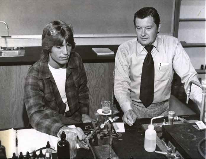 Val Christensen works in a lab with a PLNU student on an experiment