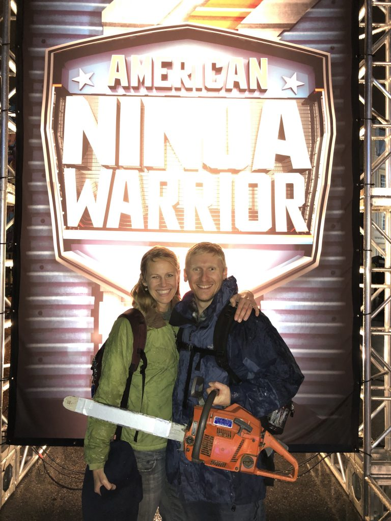 The Chainsaw Ninja smiles in front of the ANW sign