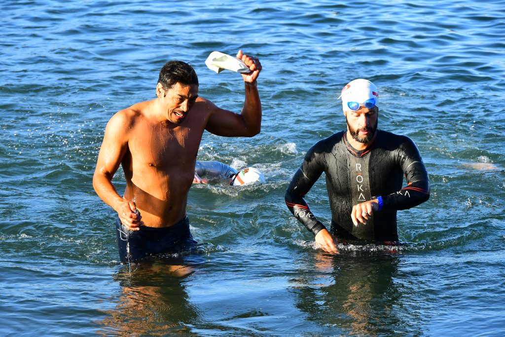 Ben Cater comes out of the water during the swim portion of a triathlon.