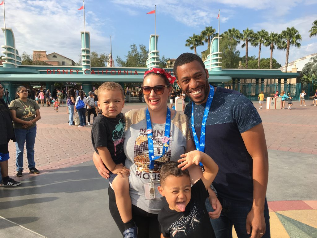 The Pullen family smiling in front of Disneyland