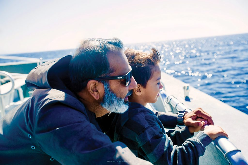Desai and his son looking out at the water.