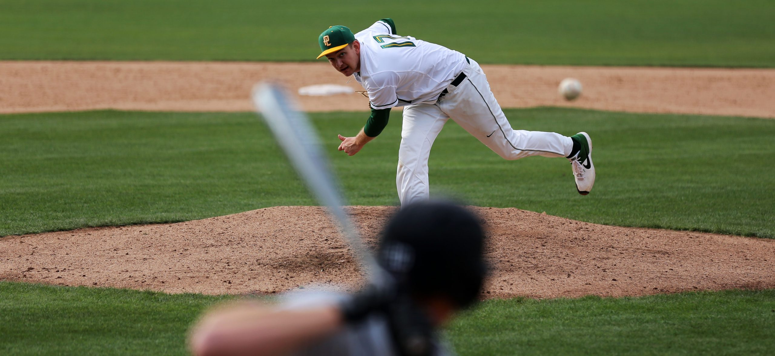 A photo of Noll throwing a pitch during a game.