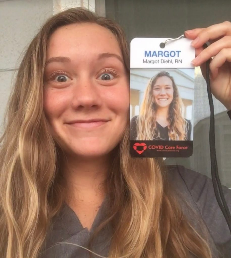 Margot smiling with her ID badge.