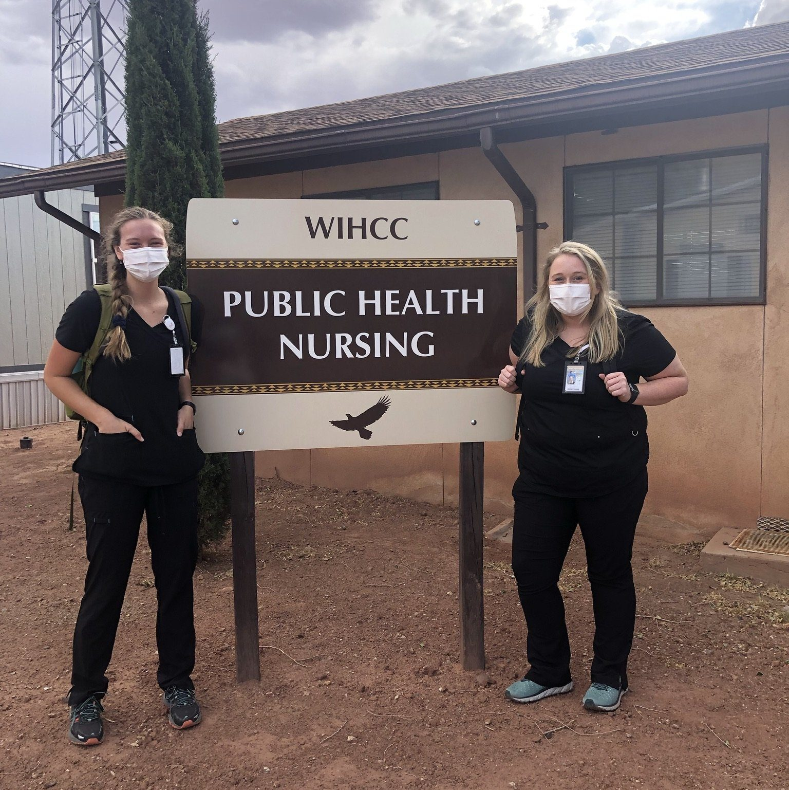 Two nursing students next to a sign that reads: WIHCC Public Health Nursing