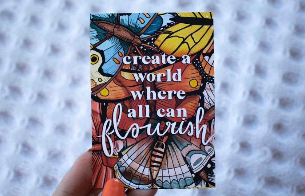 A graphic with butterflies is pictured and the words: Create a world where all can flourish